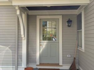 new siding and doorway with finish carpentry